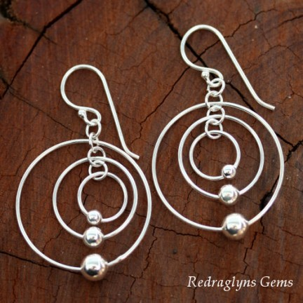 Silver Circle Twisting Earrings
